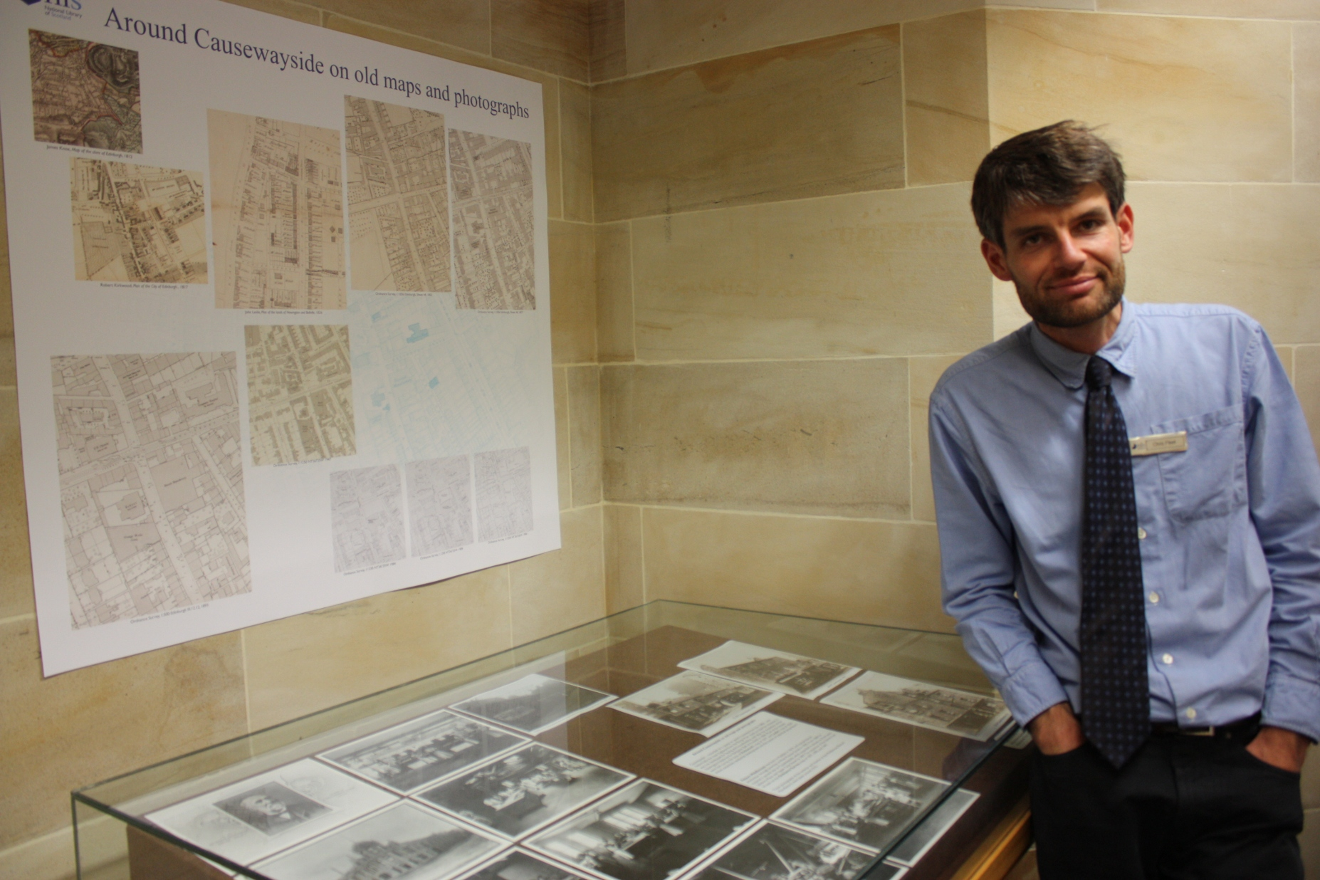 Chris Fleet stands next to part of the Causewayside in Old Maps and Images exhibit at the National Library of Scotland Maps Reading Room