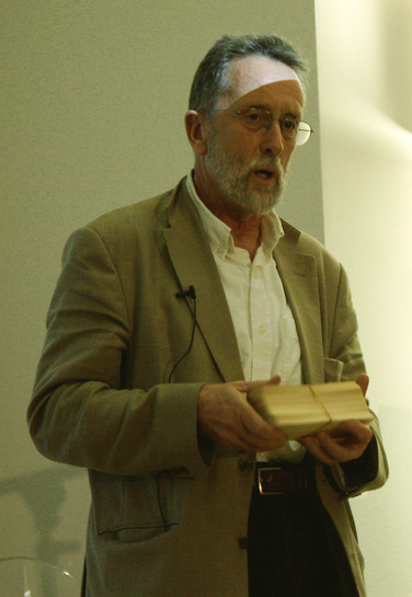 Professor Robert Morris holding punch card versions of the historical Post Office directories.